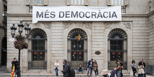 """A view of Banner """"More democracy"""" in Barcelona, Spain, on October 1, 2017. More than five million eligible Catalan voters are estimated to visit 2,315 polling stations today for Catalonia's referendum on independence from Spain. The Spanish government in Madrid has declared the vote illegal and undemocratic. (Photo by Marco Panzetti/NurPhoto via Getty Images)"""