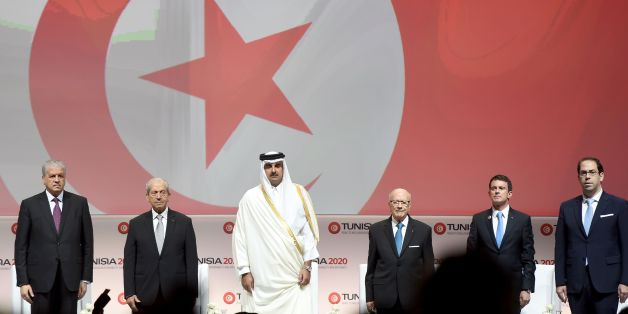 (LtoR) Algerian Prime Minister Abdelmalek Sellal: Tunisian Assembly President Mohamed Ennaceur; the Emir of Qatar, Tamim bin Hamad al-Thani; Tunisian President Beji Caid Essebsi, French Prime Minister Manuel Valls and Tunisian Prime Minister Youssef Chahed (R) stand on stage during the opening ceremony of the 'Tunisia 2020' international investment conference on November 29, 2016 in Tunis. France and Qatar promised billions of dollars of financial support to Tunisia at the launch Tuesday of a co