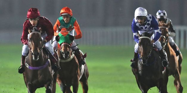 Female Qatari jockey Maryam Al-Subaiey (L) participates in a horse race at the Racing and Equestrian Club in the capital Doha on February 24, 2017.Maryam al-Subaiey who created ripples by appearing on television without a headscarf has broken new ground as a jockey in the conservative Gulf country, where men usually hold the reins. / AFP PHOTO / KARIM JAAFAR        (Photo credit should read KARIM JAAFAR/AFP/Getty Images)