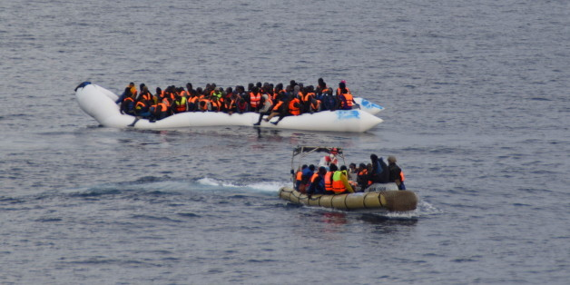 Migrants sit in their boat during a rescue operation of 219 migrants by Italian naval vessel Bettica (not seen) in this February 23, 2016 handout picture provided by Marina Militare. More than 700 migrants were rescued from six leaky boats in the sea between Tunisia and Sicily on Tuesday and four were found dead, the Italian navy said. REUTERS/Marina Militare/Handout via Reuters ATTENTION EDITORS - THIS PICTURE WAS PROVIDED BY A THIRD PARTY. REUTERS IS UNABLE TO INDEPENDENTLY VERIFY THE AUTHENTICITY, CONTENT, LOCATION OR DATE OF THIS IMAGE. FOR EDITORIAL USE ONLY. NOT FOR SALE FOR MARKETING OR ADVERTISING CAMPAIGNS. THIS PICTURE IS DISTRIBUTED EXACTLY AS RECEIVED BY REUTERS, AS A SERVICE TO CLIENTS.
