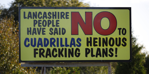 An anti fracking sign stands on the road near the village of Little Plumpton, northern England, October 6, 2016. The British government approved a new shale gas fracking permit on Thursday, overruling a local authority decision and boosting Britain's position as Europe's most promising shale gas exploration ground. REUTERS/Phil Noble