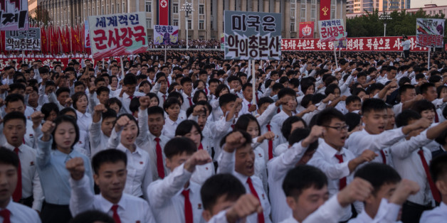 Students march during a mass rally on Kim Il-Sung sqaure in Pyongyang on September 23, 2017.Tens of thousands of Pyongyang residents were gathered in the capital's Kim Il-Sung sqaure to laud leader Kim Jong-Un's denounciation of US President Donald Trump. / AFP PHOTO / KIM WON-JIN        (Photo credit should read KIM WON-JIN/AFP/Getty Images)
