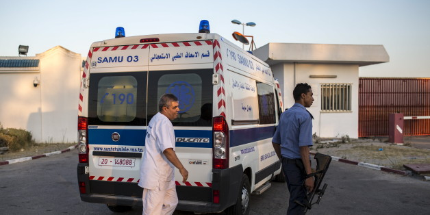 An ambulance carrying British tourists, who were wounded during the Imperial Marhaba hotel attack by a gunman, arrive to board the Royal Air Force (RAF) jet at Monastir airport, Tunisia, June 29, 2015. Hundreds of armed police patrolled the streets of Tunisia's beach resorts on Sunday and the government said it will deploy hundreds more inside hotels after the Islamist militant attack in Sousse that killed 39 foreigners, mostly Britons.REUTERS/Zohra Bensemra