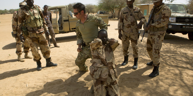 A U.S. special forces soldier demonstrates how to detain a suspect during Flintlock 2014, a U.S.-led international training mission for African militaries, in Diffa, March 4, 2014. On a dusty training ground in Niger, U.S. Special Forces teach local troops to deal with suspects who resist arrest. The drill in the border town of Diffa is part of Operation Flintlock, a counter-terrorism exercise for nations on the Sahara's southern flanks that the United States organises each year. Washington's ai