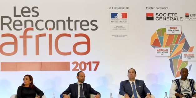 (From L-R) Utica President and former Nobel prize winner (2015) Wided Bouchamaoui French Prime Minister Edouard Philippe (L), Tunisian Prime Minister Youssef Chahed (R) and Burkina Faso Prime Minister Paul Kaba Thieba take part in a France-Africa economic meeting in Tunis on October 5, 2017. Philippe in on one day official visit to Tunisia.  / AFP PHOTO / FETHI BELAID        (Photo credit should read FETHI BELAID/AFP/Getty Images)
