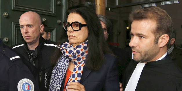 """Francoise Bettencourt-Meyers (C), the daughter of L'Oreal heiress Liliane Bettencourt, leaves the courts in Bordeaux on the opening day of the Bettencourt trial January 26, 2015. Ten people stand trial for """"abuse of weakness"""" between 2006 and 2010 in the case involving elderly L'Oreal heiress Liliane Bettencourt.   REUTERS/Regis Duvignau (FRANCE - Tags: POLITICS CRIME LAW)"""