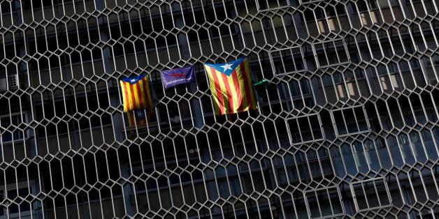 Esteladas (Catalan separatist flag) hang from windows in Barcelona, Spain October 5, 2017. REUTERS/Yves Herman