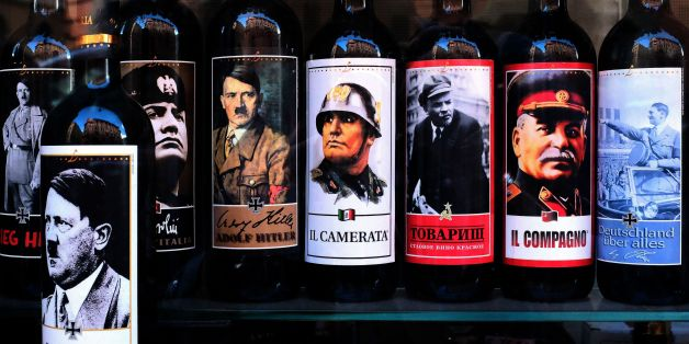 A picture taken on September 14, 2017 shows bottles of wine with pictures of Mussolini, Hitler, Lenin and Stalin at a shop in the center of Rome. Italy's lower house of Parliament voted for the introduction of an article in the penal code punishing 'anyone who propagates the images or contents of the Italian former Fascist Party or the German former Nazist Party' affects production, distribution, diffusion or sale of goods depicting people, images or symbols, and increase of one-third of the punishment for the crimes committed through the web, the rectification of the law is now awaiting voting in the Senate.  / AFP PHOTO / Alberto PIZZOLI        (Photo credit should read ALBERTO PIZZOLI/AFP/Getty Images)