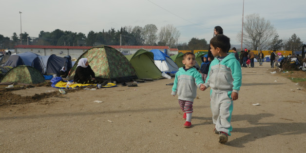 Idomeni, Greece - March 6, 2016: Refugee children are seen at the makeshift refugee camp in Idomeni, near the Greece-Macedonian border.