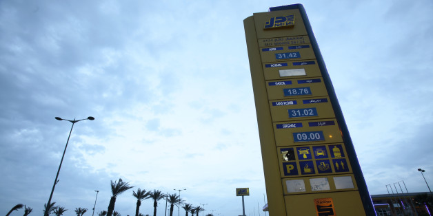 """A Naftal billboard shows prices at the entrance of the fuel station in the highway of Algiers, Algeria February 3, 2016. Unleaded fuel is priced at 31.02 dinar per litre. A dramatic drop in oil prices, driven down by a glut in supply, is translating into a mixed bag for motorists. All countries have access to the same oil prices on international markets, but retail prices vary wildly, largely because of taxes and subsidies. REUTERS/Ramzi Boudina SEARCH """"THE WIDER IMAGE"""" FOR ALL STORIES"""