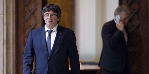 Catalan president Carles Puigdemont arrives to receive members of the Independent Commission for Mediation, Dialogue and Conciliation at the Catalan Government 'Generalitat' headquarters in Barcelona on October 6, 2017.The Catalan regional government has said it could declare independence next week. It claims voters backed the move in a referendum vote outlawed by Madrid. The political standoff has dragged Spain into its worst political crisis in decades. Catalonia accounts for a fifth of Spain'