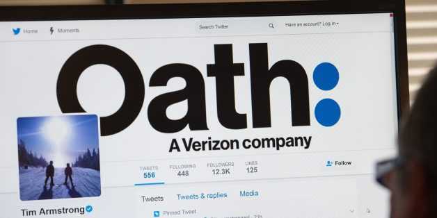 A man looks at the Twitter page of AOL CEO Tim Armstrong announcing Oath on a computer in Washington, DC, on April 4, 2017.AOL and Yahoo will be combined into a unit called 'Oath' after telecom titan Verizon buys the pioneering internet firm, according to a tweet on April 3, 2017 by the AOL chief. Confirmation of a new name for what the world has long known as Yahoo was tweeted from a verified @timarmstrongaol account after reports of the new name leaked in US media reports.'Billion+ Consumers,