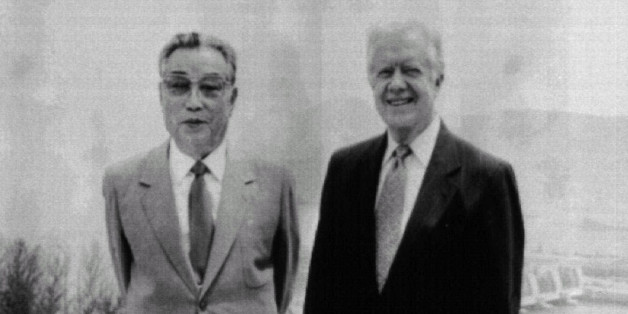 Former President Jimmy Carter (R) poses with North Korean President KimIl-sung in Pyongyang June 17. JAPAN OUT st/KNS-Kyodo REUTERSAS