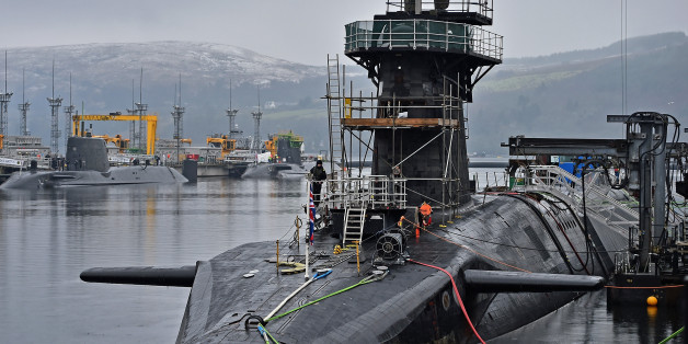 RHU, SCOTLAND - JANUARY 20:  Royal Navy security personnel stand guard on HMS Vigilant at Her Majesty's Naval Base, Clyde on January 20, 2016 in Rhu, Scotland. HMS Vigilant is one of the UK's fleet of four Vanguard class nuclear-powered ballistic missile submarines carrying the Trident nuclear missile system. A decision on when to hold a key Westminster vote on renewing Trident submarine class is yet to be decided senior Whitehall sources have admitted.  (Photo by Jeff J Mitchell/Getty Images)