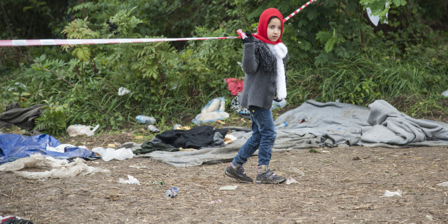 SERBIAN-CROATIAN BORDER, BAPSKA, SYRMIA, CROATIA - 2015/09/23: A child on the path leading to the Serbian-Croatian border. More refugees continue to arrive in Europe due to persecution and poverty in their homeland. (Photo by Ivan Romano/Pacific Press/LightRocket via Getty Images)