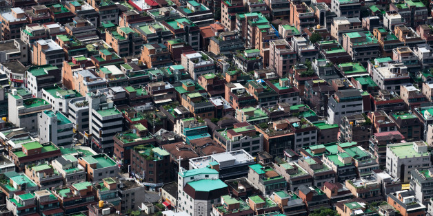Residential buildings are seen from the Seoul Sky observation deck of the Lotte Corp. World Tower in Seoul, South Korea, on Friday, Aug. 11, 2017. South Korea'sstocks and currencyfell after President Donald Trump warned North Korea that if it 'does anything' to the U.S. or its allies 'things will happen to them like they never thought possible.' Photographer: SeongJoon Cho/Bloomberg via Getty Images