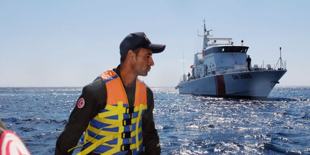 A member of the Tunisian coast guard inspects the maritime borders in the region off Tunisia's northern town of Bizerte during a 24-hour patrol of the area on March 30, 2017.Migrants seeking a better future have long used the Tunisian coast as a launchpad for bids to reach Italy. But in recent years, Tunisian authorities have had to learn to tackle a new form of smuggling -- contraband coming from Europe. / AFP PHOTO / MOHAMED KHALIL / TO GO WITH AFP STORY BY KAOUTHER LARBI         (Photo credit