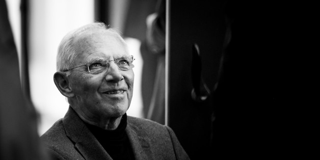 (EDITORS NOTE: Image has been converted to black and white.) BERLIN, GERMANY - SEPTEMBER 26: German Finance Minister Wolfgang Schaeuble, arrives for a joint meeting of the Bundestag parliamentarians of the CDU and its Bavarian sister party, the CSU, on September 26, 2017 in Berlin, Germany. Today's is the first meeting since German federal elections two days ago, in which the CDU won, though with 8.6% points fewer than in 2013. The CDU and CSU are now tasked with creating a new government coalition, which will most likely be with the Free Democratic Party (FDP) and the German Greens Party (Buendnis 90/Die Gruenen), though negotations will lieky be rocky. September 26, 2017 in Berlin, Germany. (Photo by Florian Gaertner/Photothek via Getty Images)
