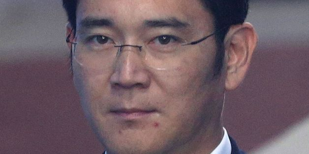 Lee Jae-yong, vice chairman of Samsung Electronics Co., arrives for his trial at the Seoul Central District Court in Seoul on August 7, 2017.South Korean prosecutors on August 7 demanded the heir to the Samsung empire be jailed for 12 years over his role in the corruption scandal that brought down the country's last president. / AFP PHOTO / POOL / Ahn Young-joon        (Photo credit should read AHN YOUNG-JOON/AFP/Getty Images)