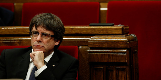 Catalan President Carles Puigdemont gestures during a plenary session in the Catalan regional parliament in Barcelona, Spain, October 10, 2017. REUTERS/Albert Gea