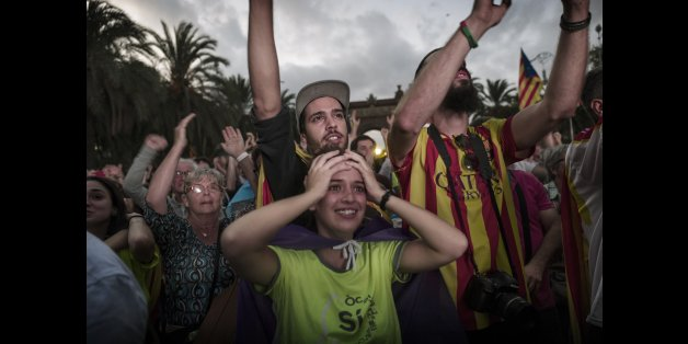 BARCELONA, SPAIN - OCTOBER 10:  Pro- independence supporters react as they hear Catalan President Carles Puigdemont announce he will abide by the independence vote as they watch on big screens outside the Parliament of Catalunya as the Catalan President Carles Puigdemont speaks on October 10, 2017 in Barcelona, Spain. After the October 1 referendum and weeks of build up Catalonia's president Carles Puigdemont addressed the Catalan Parliament where he acknowledged that his people voted for indepe