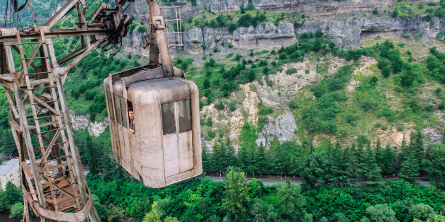 CHIATURA, GEORGIA - JUNE 2014:The cable car network spans 6,000 meters in, Chiatura, Georgia, June 2014.   THE morning commute is stressful for most, but have sympathy for the residents of a small mining town who have to travel in rusted cable cars that are more than 60 years old. Located in the town of Chiatura, Georgia, you would be forgiven for thinking you have been teleported back to the Cold War period. Built in the 1950s by the Soviet Union to transport workers around the mining town quicker  the cable cars transport visitors to a by gone era. Photographer Ioanna Sakellaraki, 26, travelled to the old mining town to snap one of the worlds longest cable car networks which boasts 17 functioning cabins  and car lines that span more than 6,000 metres (3.7 miles).  PHOTOGRAPH BY Ioanna Sakellaraki / Barcroft Images  London-T:+44 207 033 1031 E:hello@barcroftmedia.com - New York-T:+1 212 796 2458 E:hello@barcroftusa.com - New Delhi-T:+91 11 4053 2429 E:hello@barcroftindia.com www.barcroftimages.com (Photo credit should read Ioanna Sakellaraki / Barcroft Im / Barcroft Media via Getty Images)