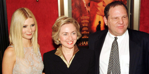 """Actress Gwyneth Paltrow (L) poses with first lady Hillary Rodham Clinton (C) and Miramax co-chairman Harvey Weinstein as they arrive for the premiere of """"Shakespeare in Love"""" in New York on December 3. [Clinton introduced the film, which stars Paltrow, Joseph Fiennes, and Geoffrey Rush. It opens in New York and Los Angeles on December 11 and nationally on Christmas Day. ]"""