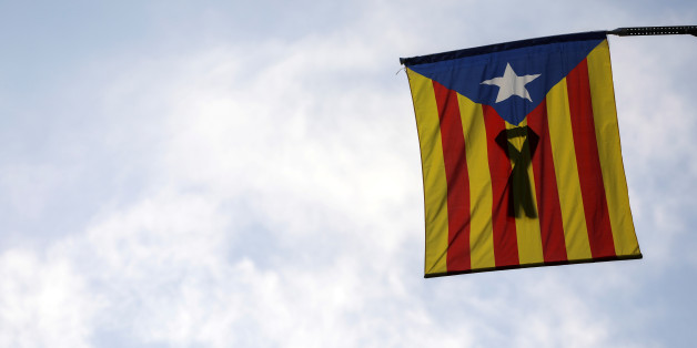 A Catalan separatist flag with a black ribbon hangs from a balcony in Barcelona, Spain, October 11, 2017. REUTERS/Susana Vera     TPX IMAGES OF THE DAY