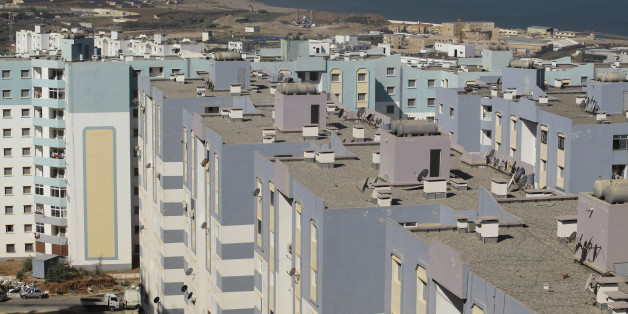 A general view shows newly constructed residential buildings in Ain Benian on the outskirts of the Algerian capital Algiers, July 8, 2013. Political and social pressures are combining to open Algeria's construction market to international competition, potentially making billion of dollars worth of contracts available to foreign companies. Housing supply has long been a source of public discontent in Algeria, which has a young and growing population of 37 million. Migration to the cities has pack
