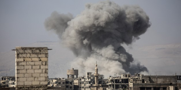 DAMASCUS, SYRIA - OCTOBER 6 : A huge explosion sends clouds into the air after Assad Regime's forces carried out air strikes over the de-conflict zone, in the Eastern Ghouta region of Damascus, Syria on October 6, 2017.  (Photo by Amer Almohibany/Anadolu Agency/Getty Images)