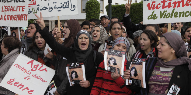 "Women from various regions of Morocco hold placards as they protest against violence towards women, in Rabat November 24, 2013. The placard reads, ""In memory of all women victims of violence"".   REUTERS/Youssef Boudlal   (MOROCCO - Tags: CIVIL UNREST SOCIETY POLITICS)"