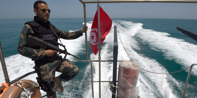 A member of the Tunisia's national guard patrols the sea bordering Tunisia and Libya for vessels potentially carrying migrants trying to reach Europe on May 5, 2015 off the coast of Tunisia's southeast port of Zarzis. AFP PHOTO/FETHI BELAID        (Photo credit should read FETHI BELAID/AFP/Getty Images)