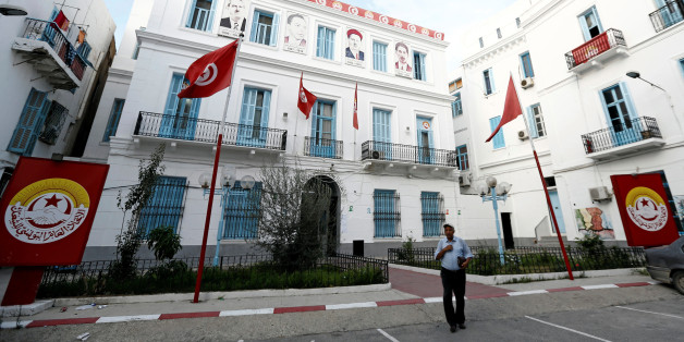 A man walks walk out of the headquarters of the General Union of Tunisian Workers (UGTT) in Tunis, Tunisia, October 5, 2016. REUTERS/Zoubeir Souissi