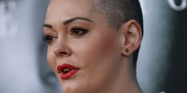 """Actress Rose McGowan poses at the premiere for the television movie """"Confirmation"""" in Los Angeles, California March 31, 2016. REUTERS/Mario Anzuoni"""