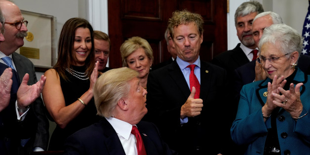Senator Rand Paul (R-KY) gives U.S. President Donald Trump a thumbs up after Trump signed an Executive Order to make it easier for Americans to buy bare-bone health insurance plans and circumvent Obamacare rules at the White House in Washington, U.S., October 12, 2017.  REUTERS/Kevin Lamarque     TPX IMAGES OF THE DAY