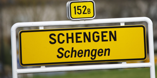 A street sign marks the beginning of the village of Schengen, Luxembourg January 27, 2016. The Schengen Agreement with the goal to eliminate internal border controls was signed on June 14, 1985 in the small village at the river Moselle and the tripoint of France, Germany and Luxembourg between the five countries of Belgium, France, Germany, Luxembourg and the Netherlands. European Union interior ministers are to discuss extending temporary border controls in the passport-free Schengen zone to control migration flows, as well as identity document fraud following France's request to improve the detection of fake Syrian passports used by people trying to get into Europe. REUTERS/Wolfgang Rattay