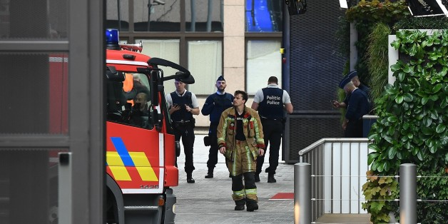Belgian rescue personnel gather at The European Council in Brussels on October 13, 2017, after noxious fumes in the kitchen led to kitchen staff falling ill.  