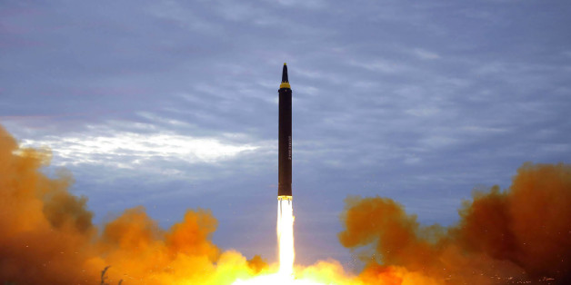TOPSHOT - This picture from North Korea's official Korean Central News Agency (KCNA) taken on August 29, 2017 and released on August 30, 2017 shows North Korea's intermediate-range strategic ballistic rocket Hwasong-12 lifting off from the launching pad at an undisclosed location near Pyongyang.Nuclear-armed North Korea said on August 30 that it had fired a missile over Japan the previous day, the first time it has ever acknowledged doing so. / AFP PHOTO / KCNA VIA KNS / STR / South Korea OUT /