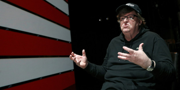 Michael Moore speaks during an interview at the site of his one-man Broadway show at the Belasco Theatre in Manhattan, New York, U.S., August 17, 2017.  REUTERS/Shannon Stapleton