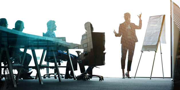 Multiple exposure shot of colleagues in a presentation superimposed over an urban background