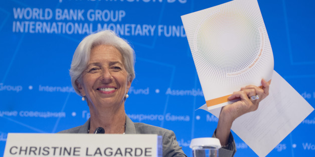 IMF Managing Director Christine Lagarde holds up the Global Policy Agenda during a press conference during the World Bank Group / International Monetary Fund Annual Meetings at IMF Headquarters in Washington, DC, October 12, 2017. / AFP PHOTO / SAUL LOEB        (Photo credit should read SAUL LOEB/AFP/Getty Images)