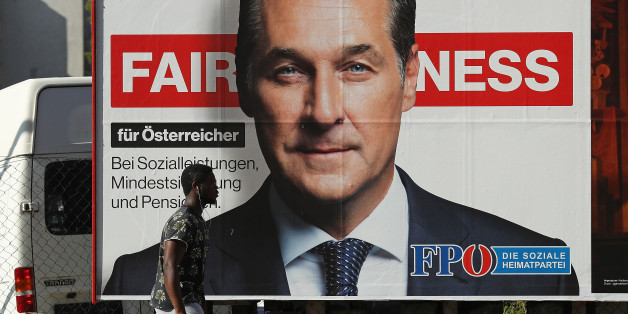 VIENNA, AUSTRIA - OCTOBER 14:  A man of African origin walks past an election campaign billboard that shows Heinz-Christian Strache, lead candidate of the right-wing Austria Freedom Party (FPOe), on October 14, 2017 in Vienna, Austria. Austria faces parliamentary elections on October 15 and the FPOe, which is running on a 'fairness for Austrians' campaign with strong anti-immigrant, anti-refugee and anti-Islam tones, is currently in third place in polls and could well become a coalition partner