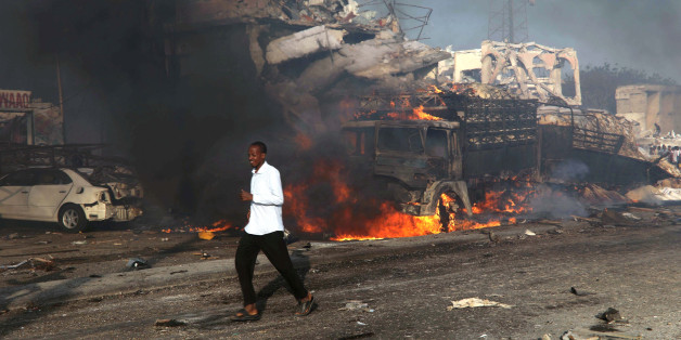 A man runs past the scene of an explosion in KM4 street in Hodan district of Mogadishu, Somalia October 14, 2017. REUTERS/Feisal Omar
