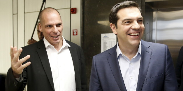 Greek Finance Minister Yanis Varoufakis (L) welcomes Prime Minister Alexis Tsipras for a meeting at the ministry in Athens, Greece May 27, 2015. Fiscal targets, pension and labour market reform and the size of the civil service are the key issues yet to be agreed between Greece and its international creditors in debt talks as Athens' cash dries up, the European Commission said on Wednesday. REUTERS/Alkis Konstantinidis      TPX IMAGES OF THE DAY