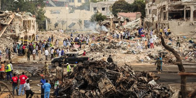 TOPSHOT - EDITORS NOTE: Graphic content / A picture taken on October 15, 2017 shows a general view of the scene of the explosion of a truck bomb in the centre of Mogadishu.A truck bomb exploded outside a hotel at a busy junction in Somalia's capital Mogadishu on October 14, 2017 causing widespread devastation that left at least 20 dead, with the toll likely to rise. / AFP PHOTO / Mohamed ABDIWAHAB        (Photo credit should read MOHAMED ABDIWAHAB/AFP/Getty Images)