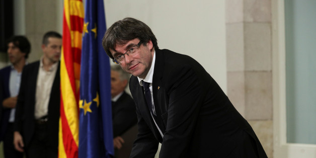 Catalan President Carles Puigdemont signs a declaration of independence at the Catalan regional parliament in Barcelona, Spain, October 10, 2017. REUTERS/Albert Gea