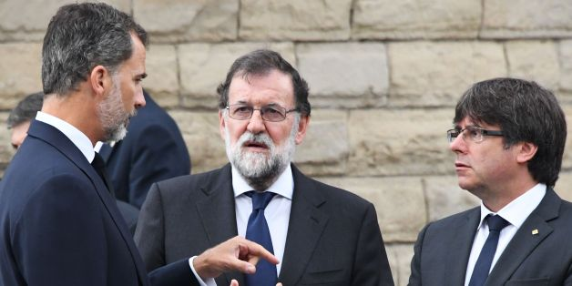(From L) Spain's King Felipe VI, Spanish Prime Minister Mariano Rajoy, President of Catalonia Carles Puigdemont arrive for a mass to commemorate victims of two devastating terror attacks in Barcelona and Cambrils, at the Sagrada Familia church in Barcelona on August 20, 2017.A grief-stricken Barcelona prepared today to commemorate victims of two devastating terror attacks at a mass in the city's Sagrada Familia church. As investigators scrambled to piece together the attacks which killed 14 peop