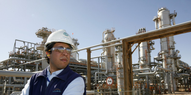 ALGERIA - DECEMBER 14:  Employee Sofian Benyamina pauses at work at the In Salah Gas (ISG) Krechba Project, run by Sonatrach, British Petroleum (BP), and StatoilHydro, in the Sahara desert near In Salah, Algeria, on Sunday, Dec. 14, 2008. From produced gas, the carbon capture plant, the largest and first of its kind, removes annually the carbon dioxide emissions equivalent of 200,000 automobiles running 30,000 kilometers. The CO2 is then reinjected into a two-kilometer deep reservoir instead of