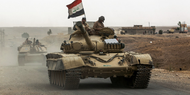 Iraqi soldiers ride atop the turret of a Russian-made T-72 tank, as Iraqi forces advance towards the city of al-Sharqat on September 20, 2017, where Iraqi forces backed by Hashed al-Shaabi (Popular Mobilisation) paramilitaries are preparing to retake the jihadist-held city of Hawijah in the province of Kirkuk, 300 kilometres (185 miles) northwest of Baghdad. / AFP PHOTO / AHMAD AL-RUBAYE        (Photo credit should read AHMAD AL-RUBAYE/AFP/Getty Images)