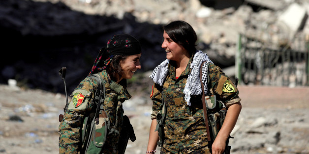 Female fighters from Syrian Democratic Forces (SDF) react in Raqqa, Syria, October 16, 2017. REUTERS/Rodi Said
